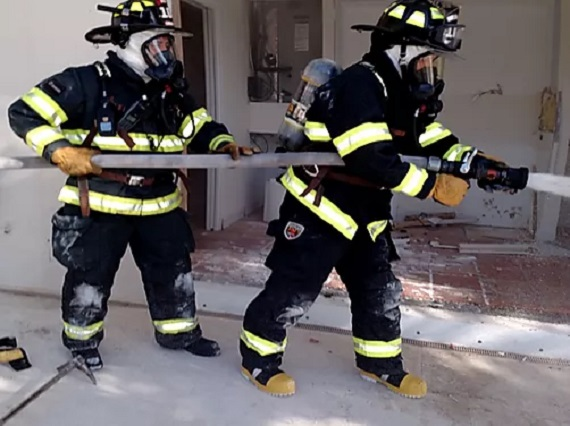 Fire Department Holding a Hose